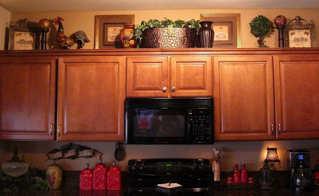 Decorating above cabinets….some ideas…maybe a rooster/wine