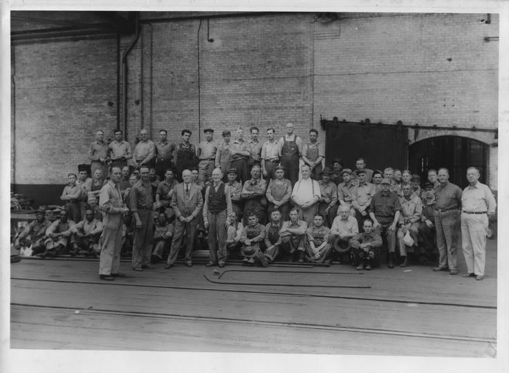 Men in the Central of Savannah repair shop