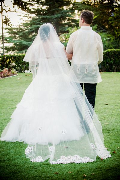 his bride had a seamstress cut out the beaded flowers from her mother's dress, and she applied them to the bottom of her own veil. - Krista ...