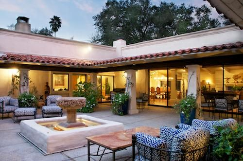 cliff may hacienda style homes. Gorgeous open courtyard. Large white French doors with paneled windows. Outdoor seating. Fountain