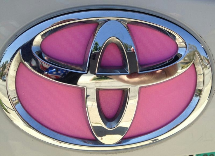 Pink Toyota logo. We specialize in custom builds. Contact
