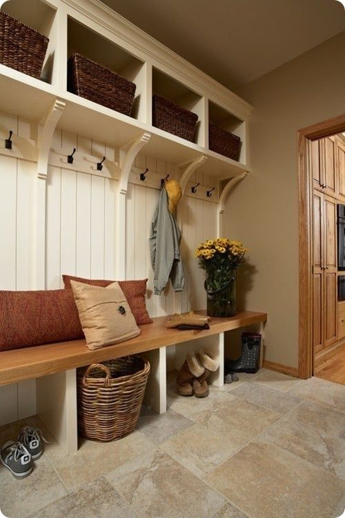 The mud room plan with nice floor, baskets & coat hooks. Like the natural wood bench top.