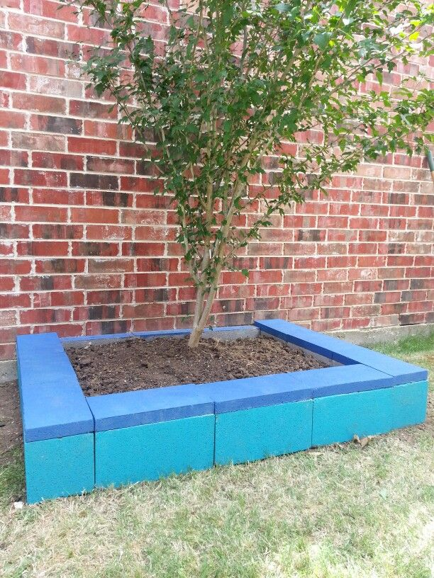 Painted cinder block raised garden bed using left over