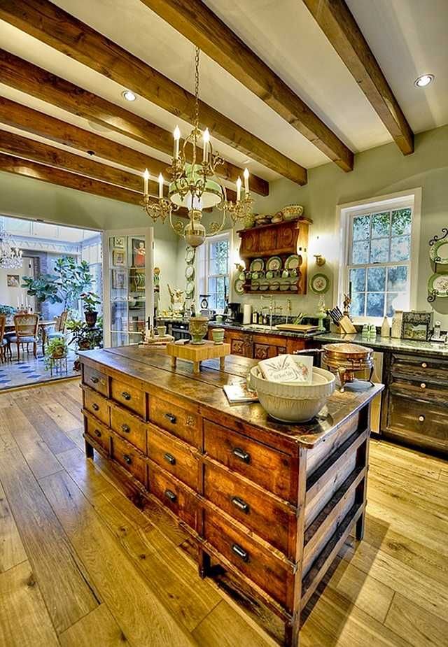 I love this entire kitchen, but this island full of drawers (knock off antique?)
