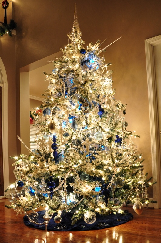 This is our flocked tree decorated with crystal, glass