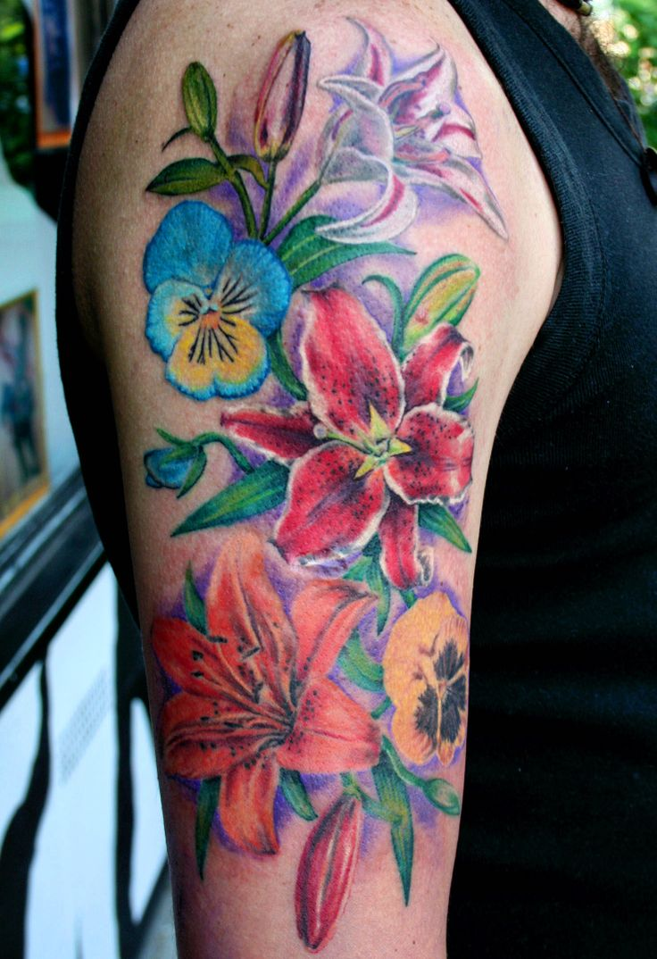 flowers tattoo by Mirek vel Stotker;lilies,pansy flowers