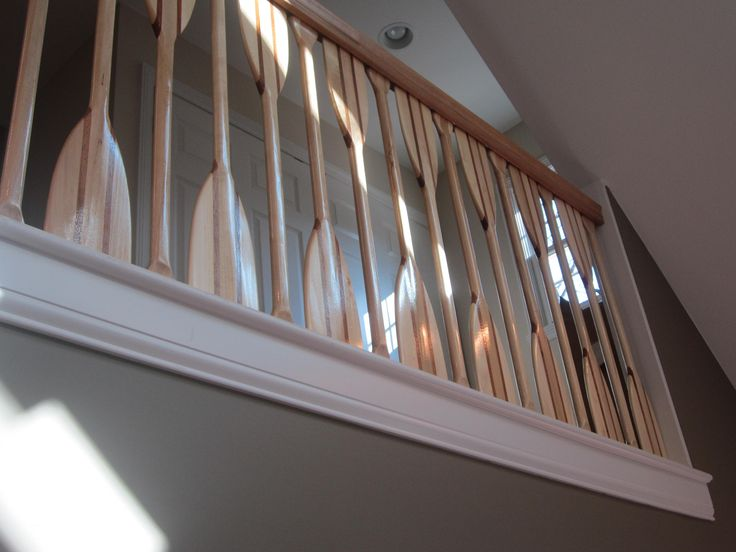 A Look Up At The Hallway Landing Railing Created Out Of
