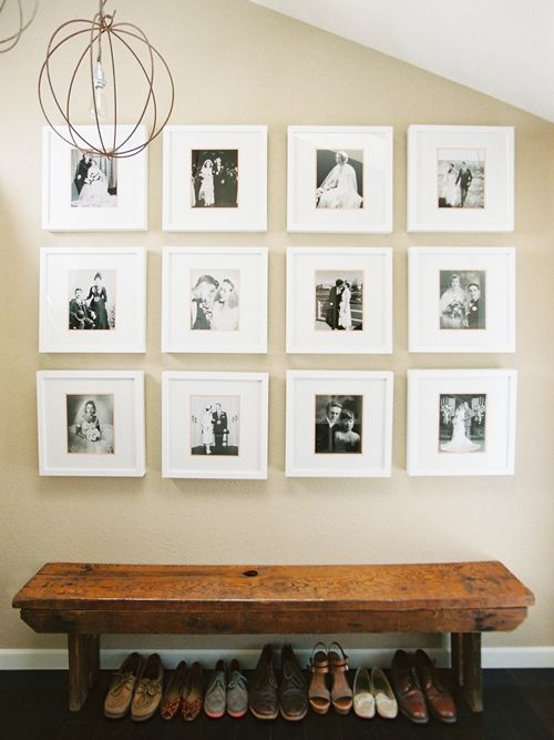 "Home owner said, ""We loved the idea of displaying these wedding photos of va"