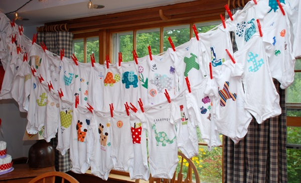 Great idea – Have guest decorate prepurchased onsies at the shower in all sizes and sleeve