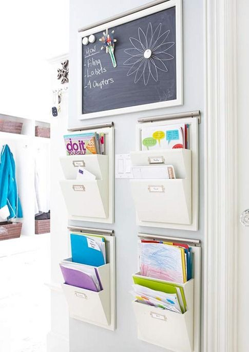Hang wall organizers to minimize paper clutter and assign each one to a family member to keep track of sports schedules, homework, or other important paperwork: