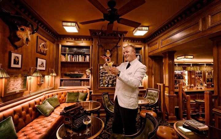 Colin Field raises a glass in the newly-restored by still very cozy Bar Hemingway in the Ritz Paris.
