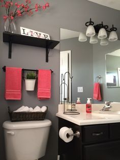Bathroom decor tips on a budget… Love this gray and red!
