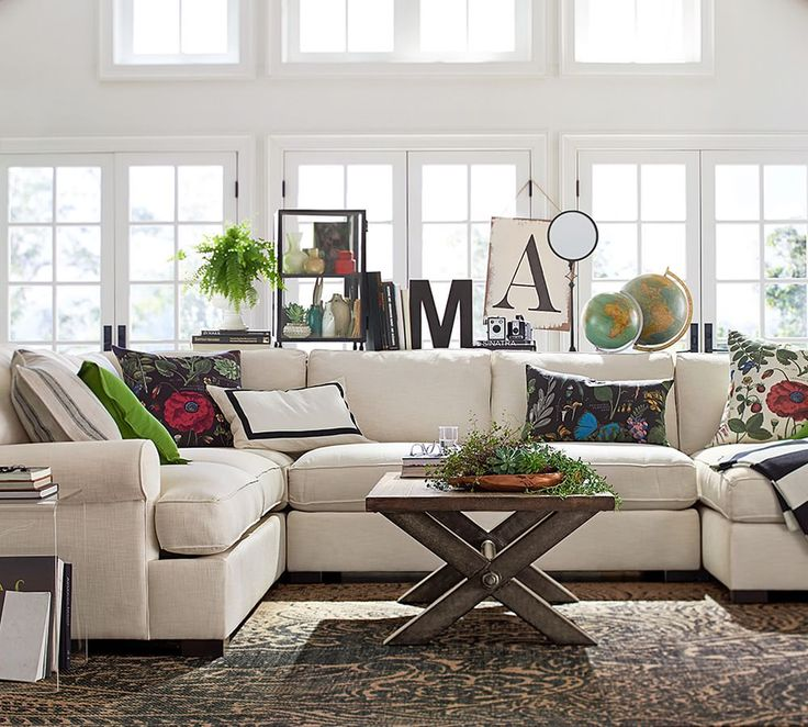 Liven up neutral furniture by swapping out your accessories like throw pillows. All you need is three hits of the same color for a