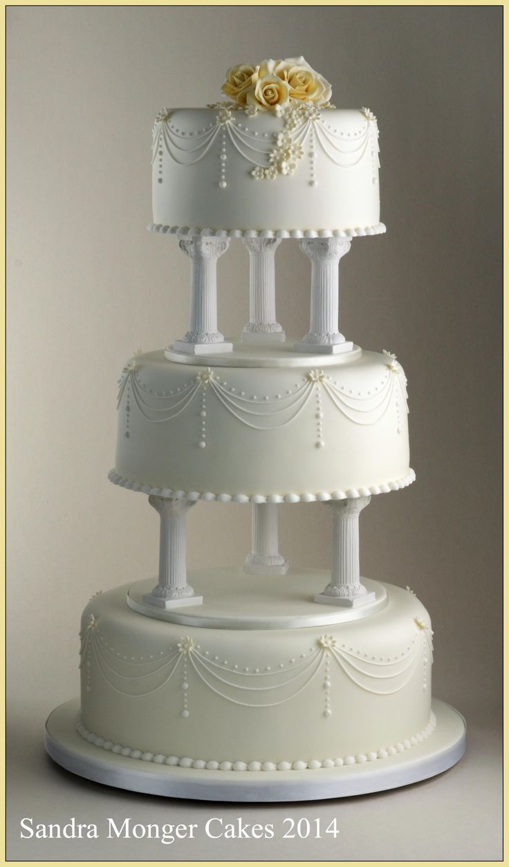 Classic Pillar Wedding Cake With Piped Swags And Flowers