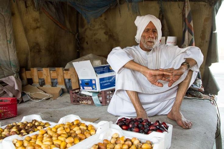 Bahraini old man in his shop selling dates. Bahrain