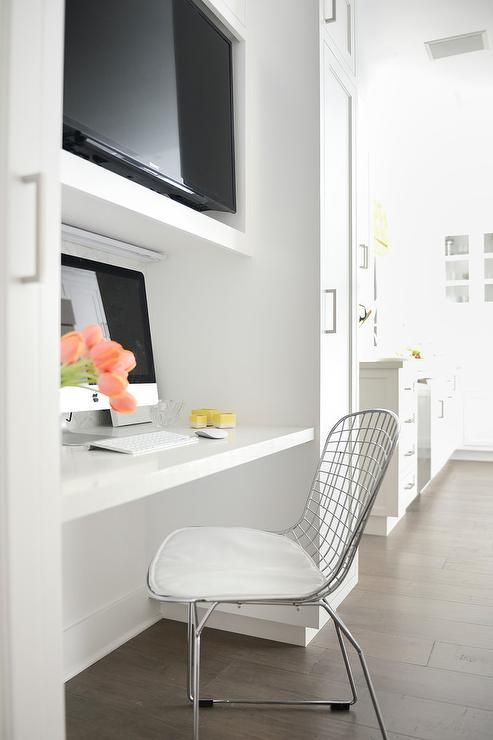 KItchen Nook Features A White Floating Desk Paired With A
