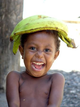 kommaar: laughing kid from irian jaya