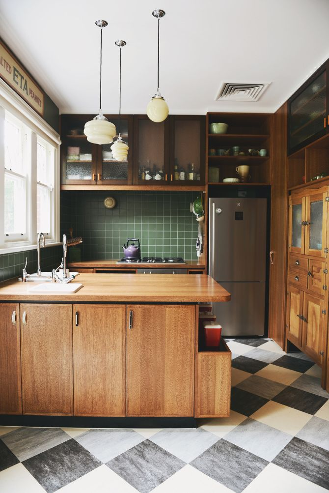Kitchen with wood green tile backsplash, and
