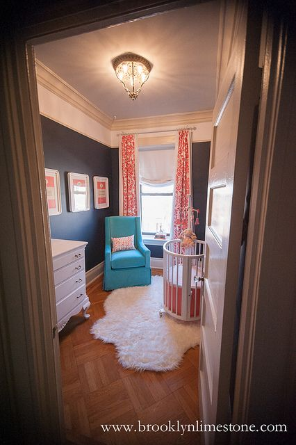 Wouldn't think to do dark walls in a #nursery, but this works! Love the pop of #turquoise and #coral