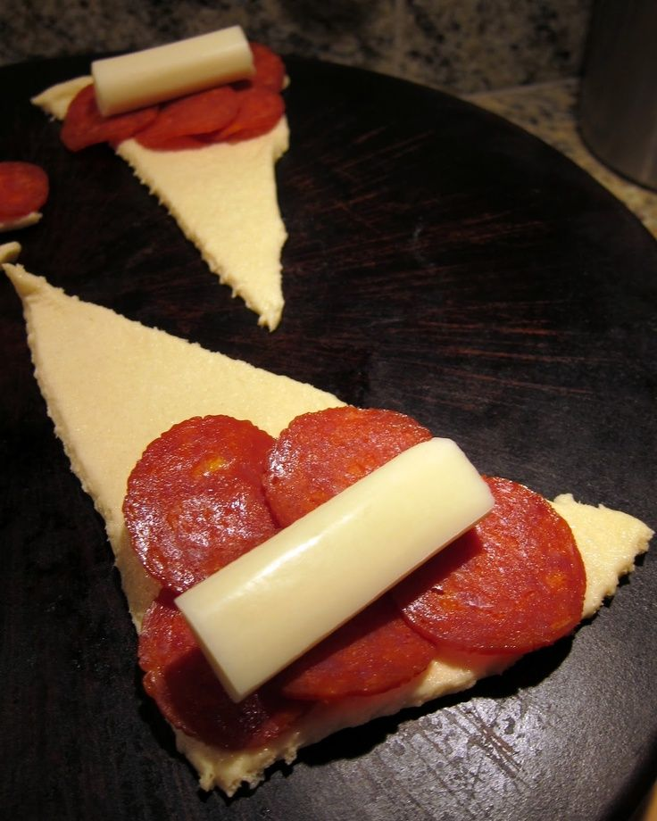 Great idea! Crescents, pepperoni, 1/2 string cheese, roll up, sprinkle w/garlic