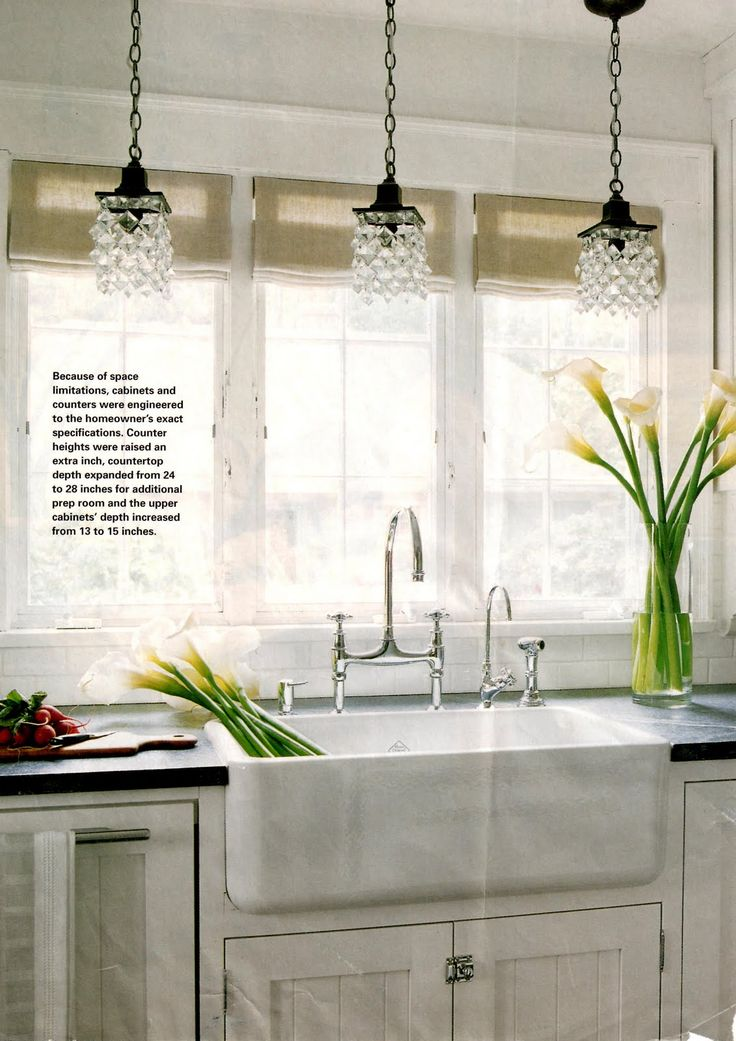 chandelier(s) above farmhouse kitchen sink, nickel faucet