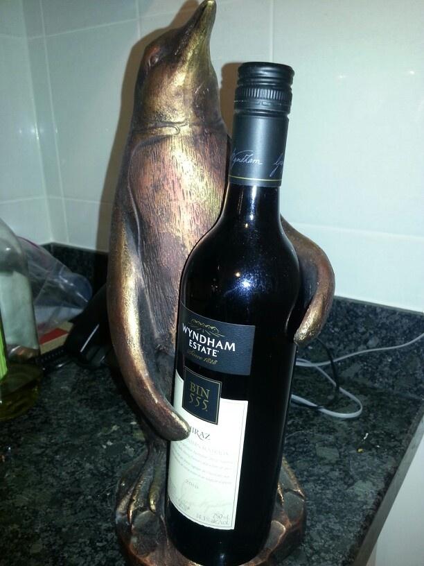 Bronze penguin wine bottle holder I think I need one of