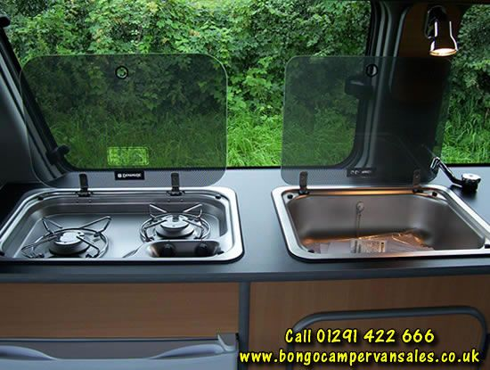 Glass Covered Cooktop And Sink For Small Kitchenette