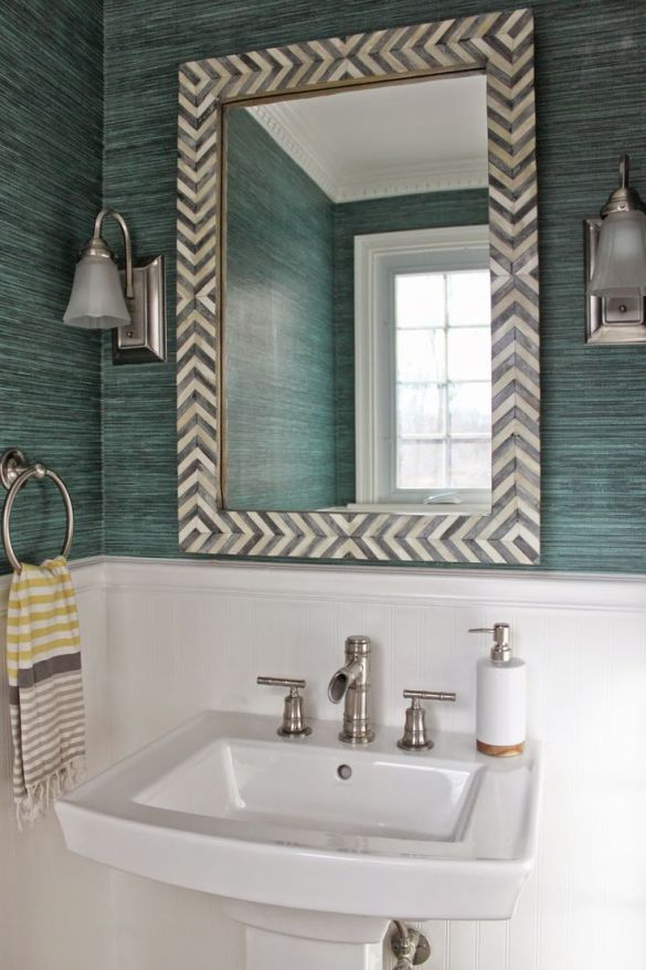 Powder Room reveal. Spoon flower green grasscloth wallpaper and West Elm Parsons mirror.:
