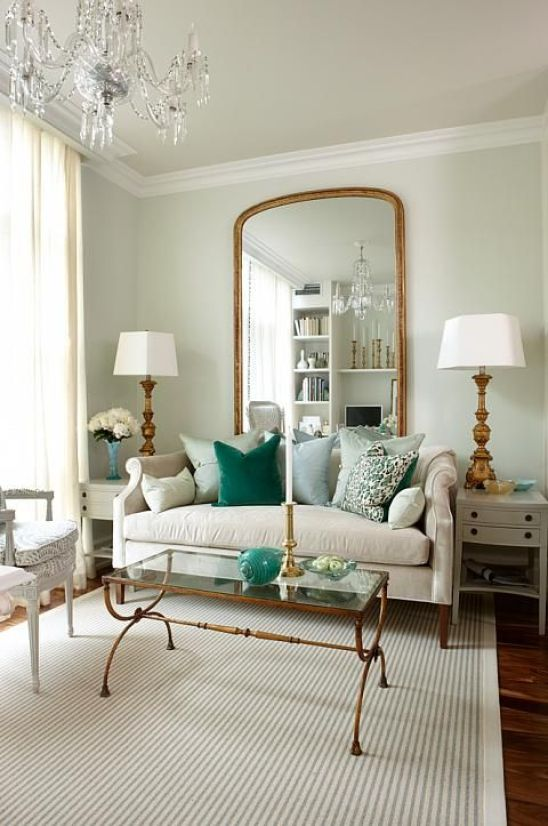 Love the gold accents and cool, fresh colours in this small living room by Sarah Richardson