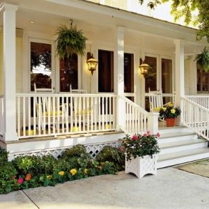 Classic front porch with ferns and flowers via Four Generations Under One Roof #porch