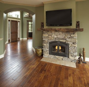 Country Residence – traditional – living room – calgary – by Maillot Homes I like the mantle and the color of the hard wood