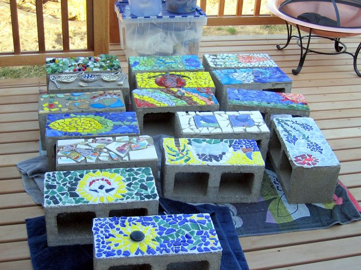 Cinder Block Mosaics :)  Lay them holes up to plant in.  Can use block to line a path or create a raised garden