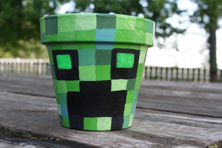 Clay pot with hand painted Creeper from Minecraft. Eyes
