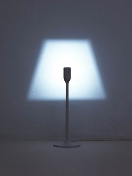 This minimalist lamp is a recent creation of the Japanese studio YOY, who's work we previously featured. The piece, laconically titled Light, is a modern take on an old concept. It breathes new life into a familiar lampshade idea. Thanks to the cleverly shaped LED fixture, the lamp produces a lampshade-like projection on the wall.