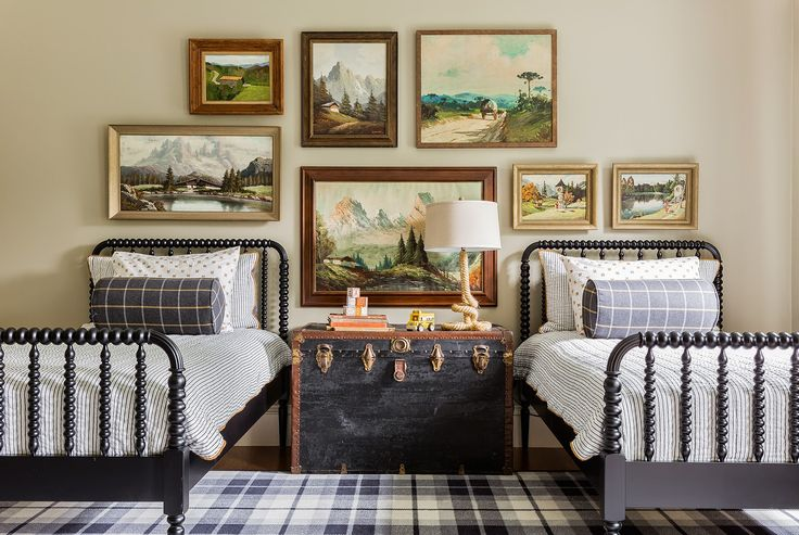Cute room – love the Jenny Lind beds, trunk and plaid rug, swap the art for something more fun and its a great kids room!