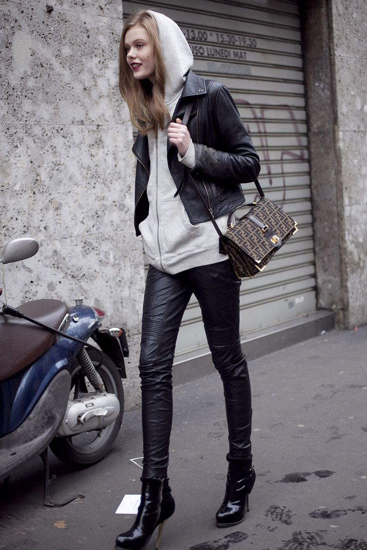 Frida Gustavsson wearing a hoodie under a cropped biker