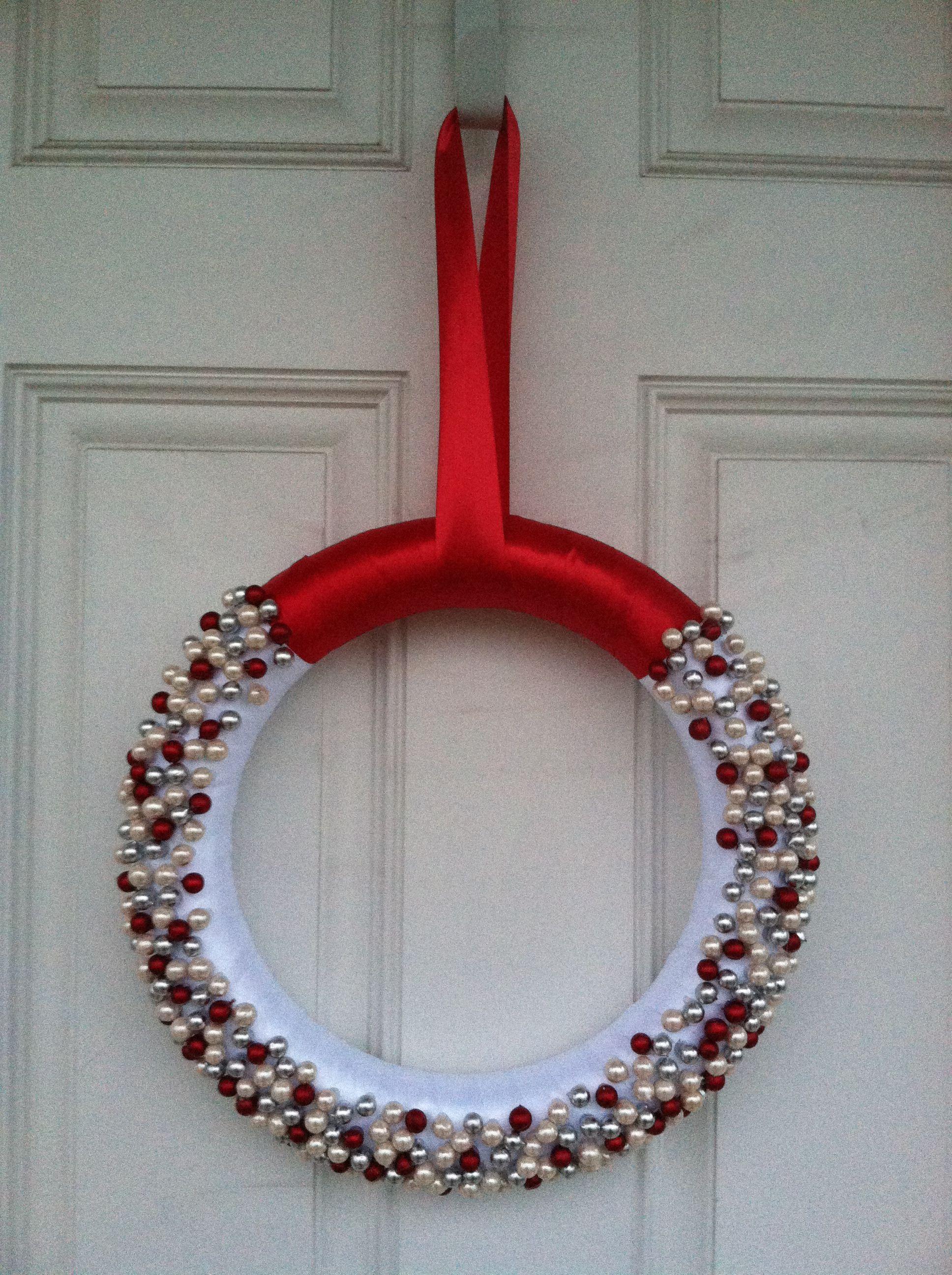 DIY Christmas wreath. Wrap foam wreath with ribbon then