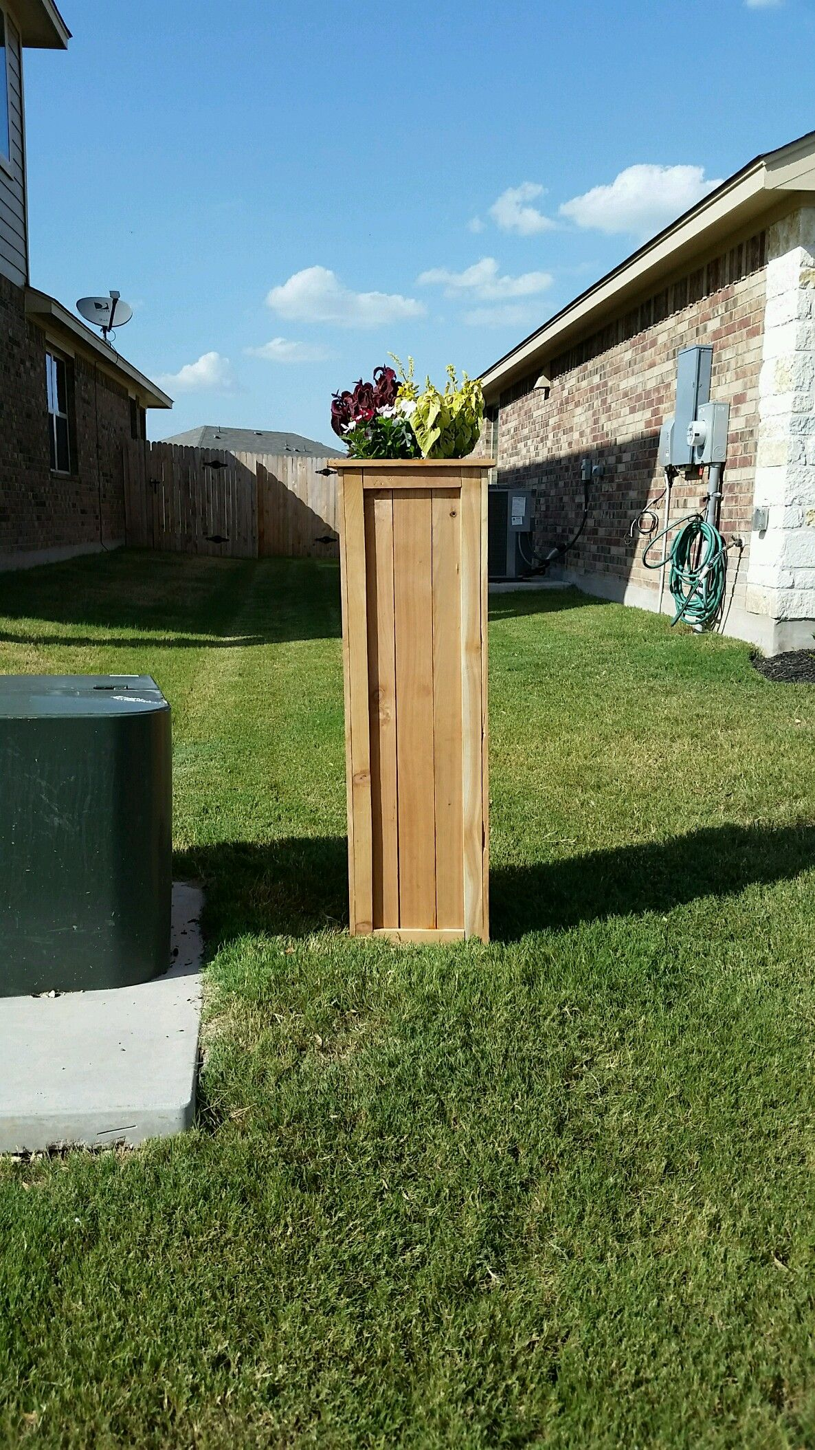 I covered my ugly utility pole with a tall planter style