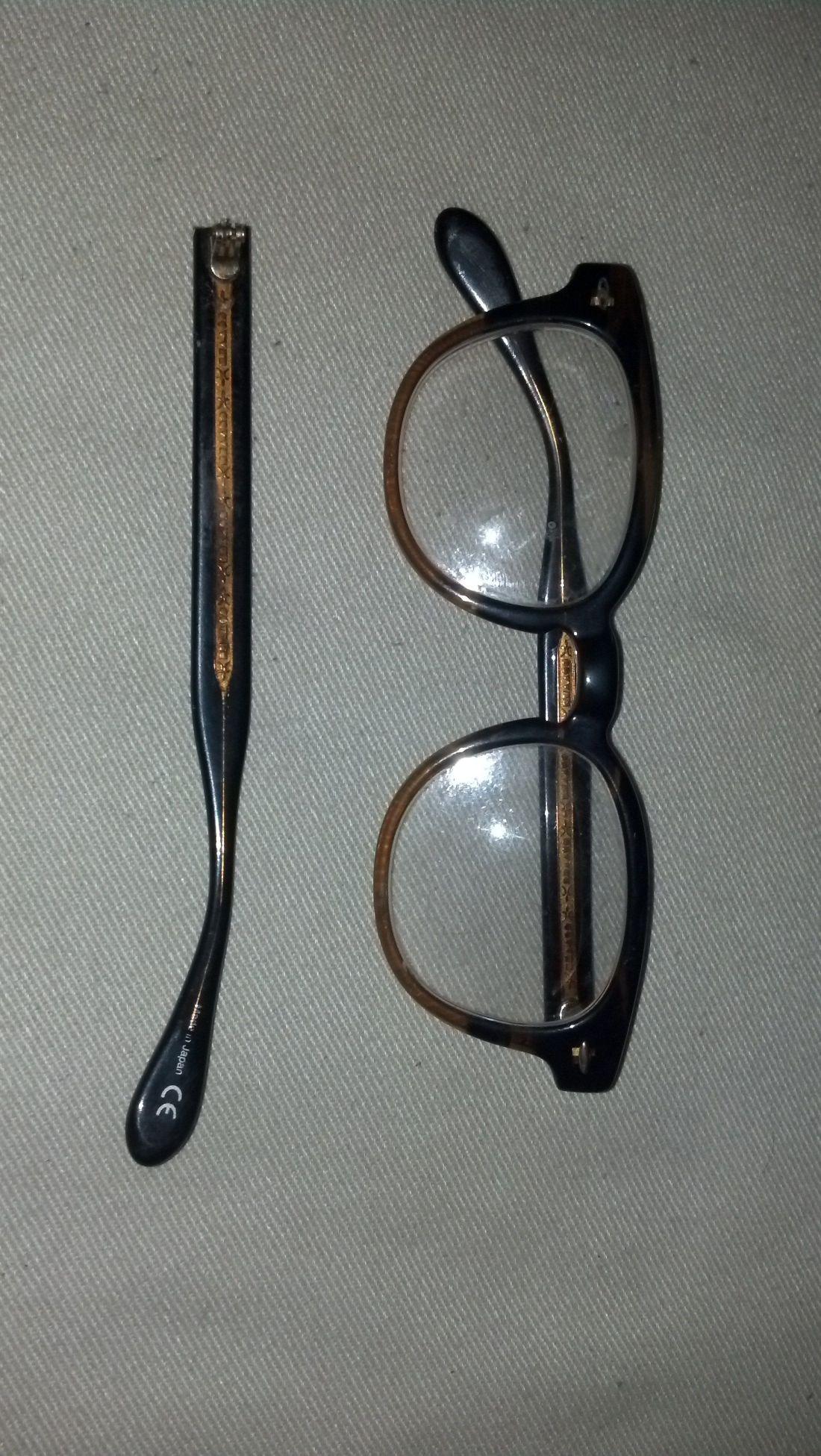 Before shot of plastic eyeglasses with broken temple arm