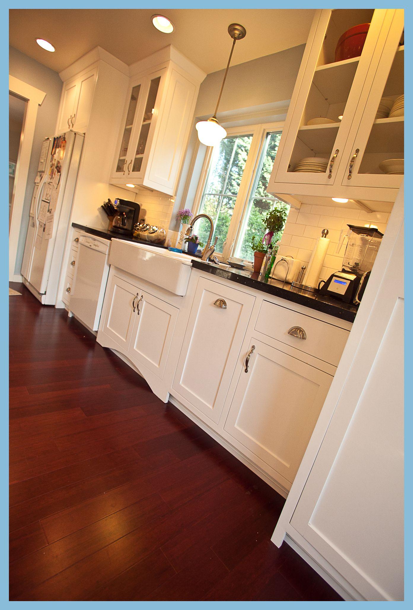 kitchen, black counters white farm sink, school