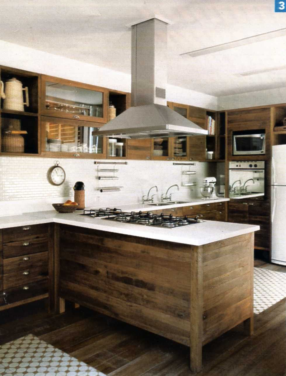 Modern kitchen with raw wood white back splash