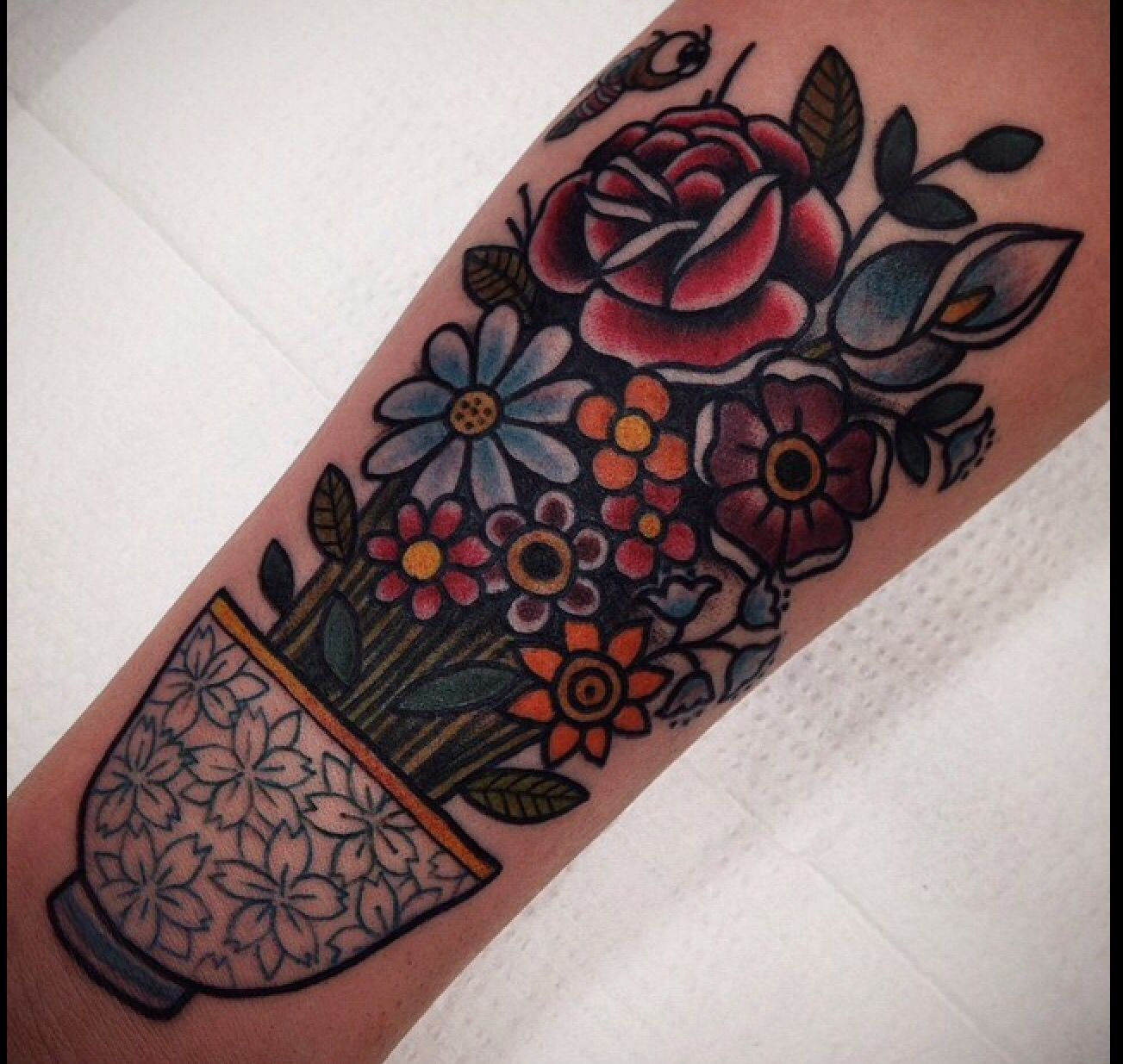 Traditional flower tattoo with tea cup. Myra Oh Florida