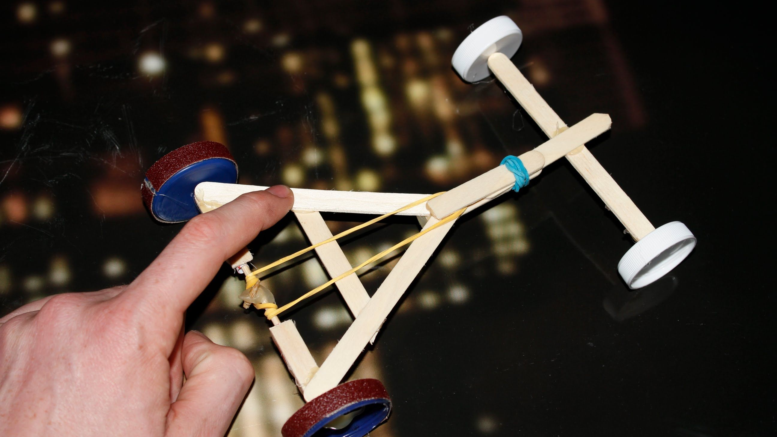 How to make a Rubber Band powered Car ( Homemade Toy
