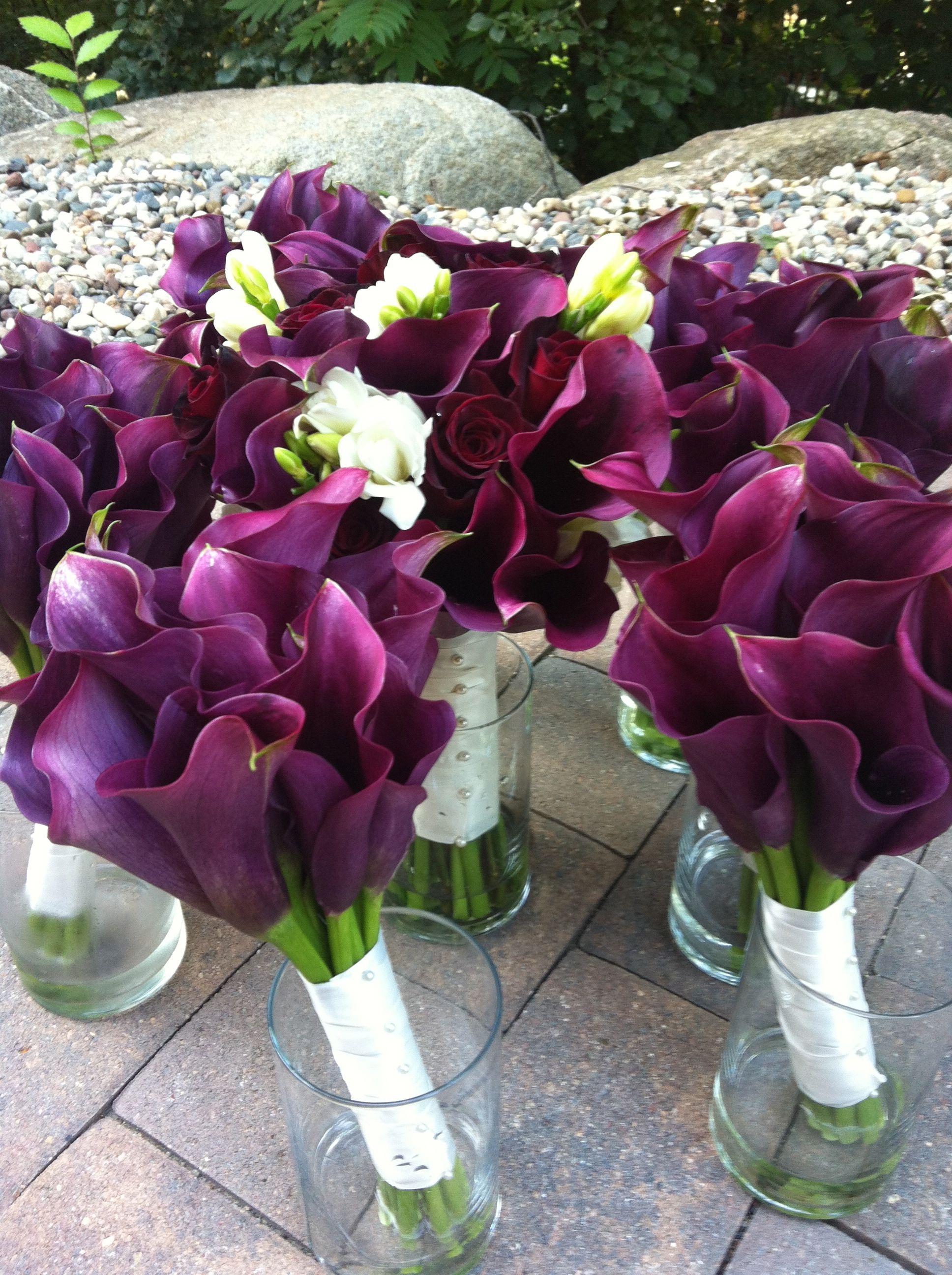 Wine colored wedding, purple calla lilies, baccara roses