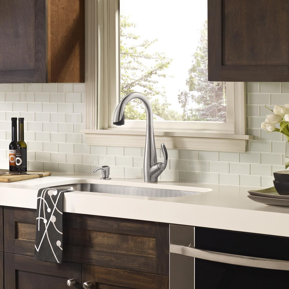 white glass tile backsplash, white countertop with dark