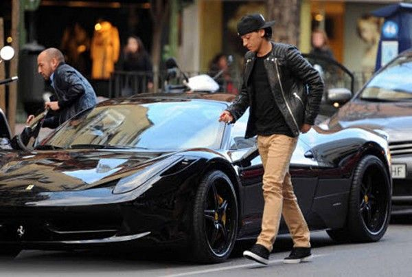 Image result for Ozil with his Ferrari 458 car