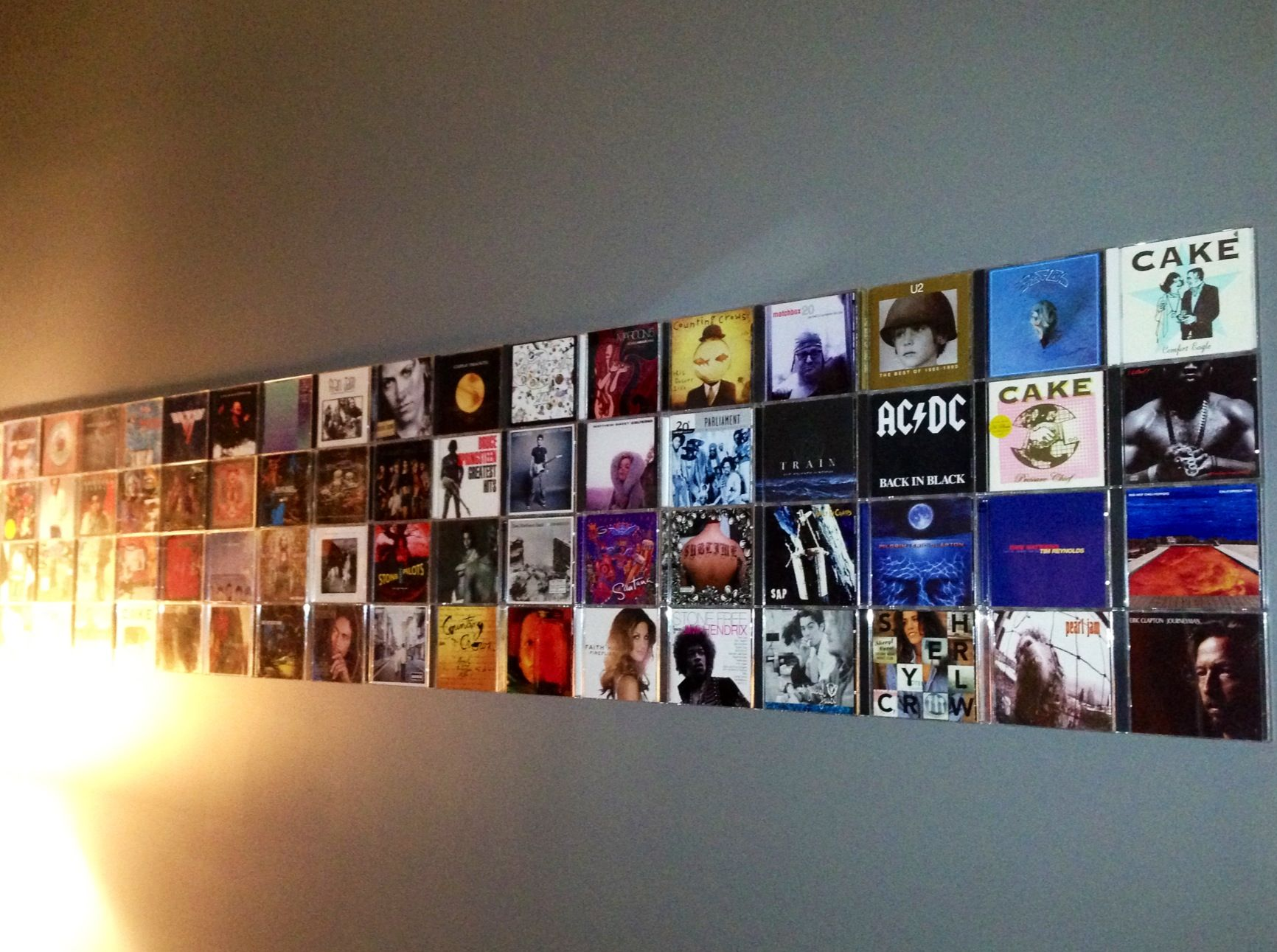 cd wall artattach the cases with 3m adhesive strips. you could