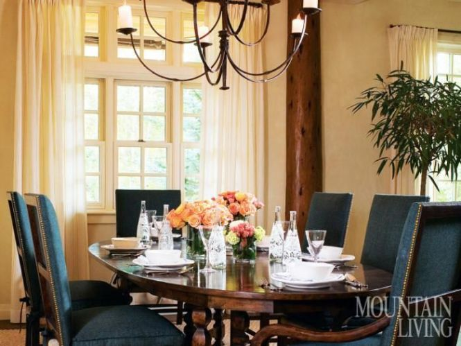 A Walnut Dennis Leen Table Is Paired With Chairs From Formations That Feature Rush Seats And Linen Cushions Topped Rose Tarlow Fabric Chandelier By