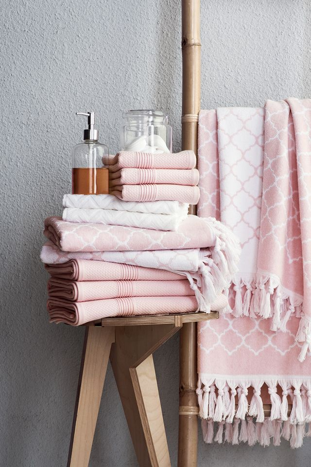 update your bathroom with soft towels, plush bathroom rugs and