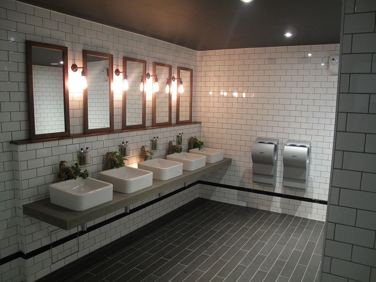 Cool industrial toilet design. With stylish subway tiles